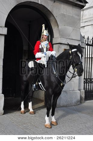LONDON – SEPTEMBER 24: A cavalry trooper is posted outside the Horse Guards on September 24, 2011 in London, England. The Queens Cavalry was formed for 130 years ago.
