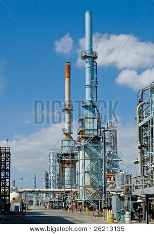 Oil refinery for making gasoline, diesel, and other fuels along with pollution and harm to the environment