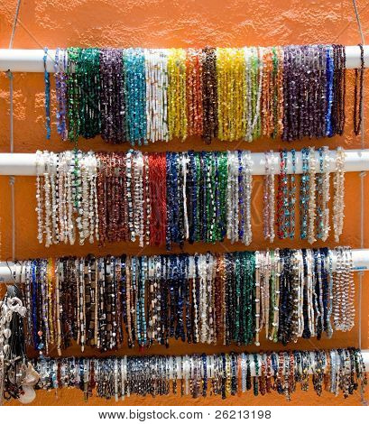 Bright and colorful mexican bracelets and jewelry for sale at the bazaar or marketplace by vendors