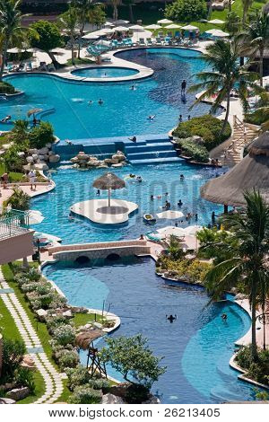 Mexican Caribbean Resort Hotel in the tropics with swimming pools, beach, and the ocean