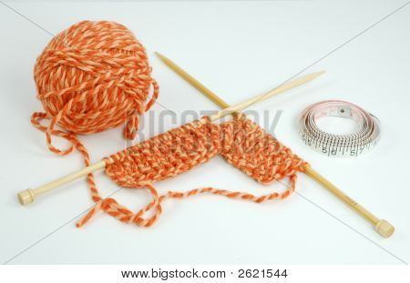 Ball Of Knitting Yarn With A Knitted Swatch