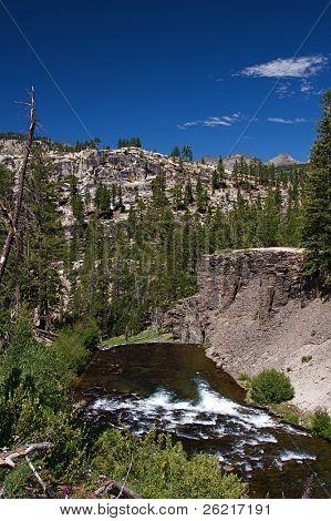 Roaring mountain river rushing over Rainbow Falls