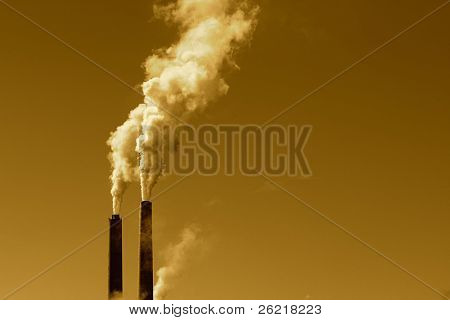A tall smokestack spewing out dirty polluted smoke
