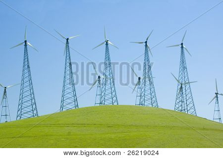 tall alternate energy wind generators on a hill in california