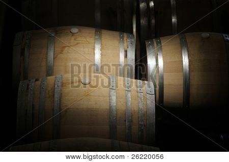 Wine barrels in a dark cavern while wine ferments