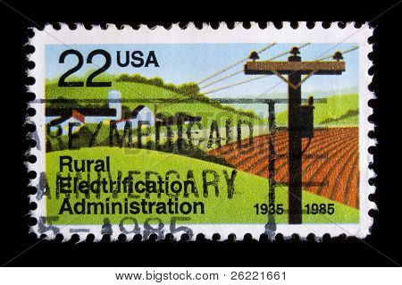 "UNITED STATES - CIRCA 1985: depicting ploughed field and power lines, in-scripted ""Rural Electrification Administration"" , value 22c, circa 1985"