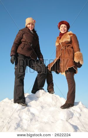 Two Young Woman On Snow Hill