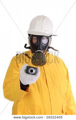 closeup of  a worker in gas mask, helmet and hazmat suit holding a geiger counter