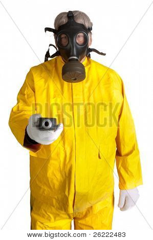 Man in a rubber hazmat suit wearing a gas mask and holding a geiger counter