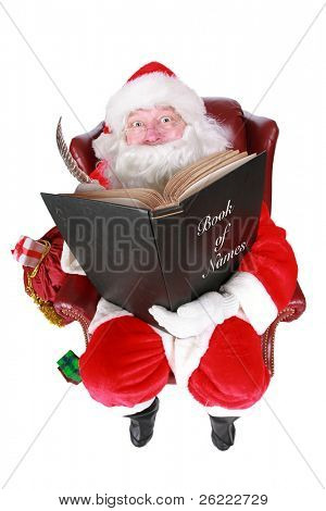 Closeup of Santa Claus (that jolly old elf that  lives at the North Pole) reading and writing in the book of good children, taken with a fish eye lens for added humor