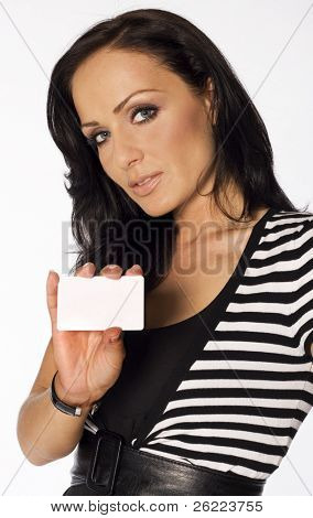 Beautiful smiling woman holding a membership card, bank or credit card, business card