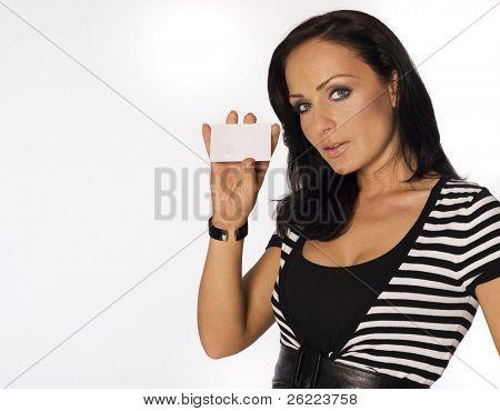 Beautiful smiling woman holding a membership card, bank or credit card, business card