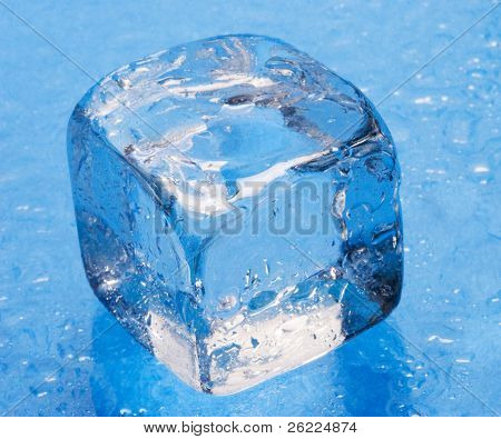 ice cube on blue background with water drops