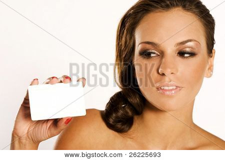 Beautiful smiling woman holding a membership card