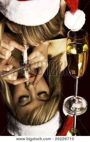 sad Santa girl reflecting in a glass taking a dose of drug through her nose