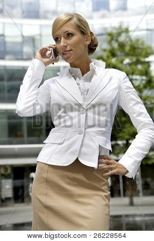 attractive and confident businesswoman talking on the phone
