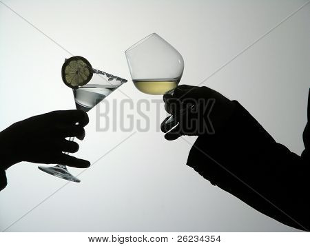 Two hands holding glasses