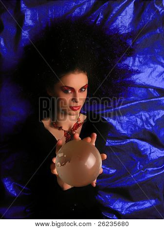 Lady With MakeUp and Crystal Ball on blue background