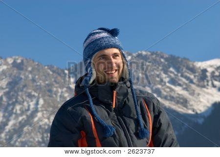 Smiling Man In Winter Mountain