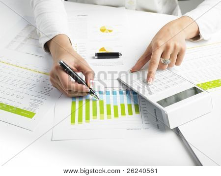 Market Analyze - pen and calculator on papers