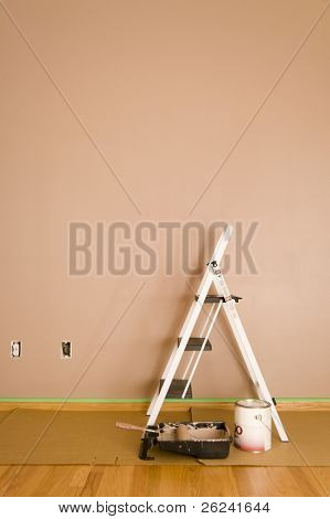 Freshly painted interior wall with ladder and tools