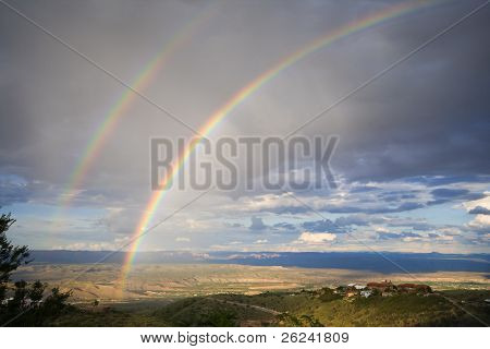 Double rainbow over valley in Arizona