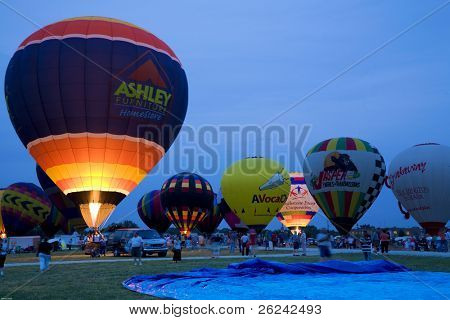 Indianapolis, IN - August 5: hot air balloons light up the evening sky at the Indiana state fairgrounds
