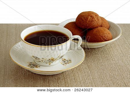 retry cup of black coffee and brown cakes