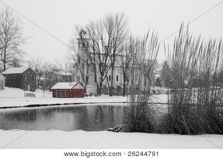 Falling snow on a historic homestead...black and white with touch of color