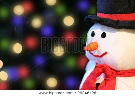 plush snowman with Christmas light background
