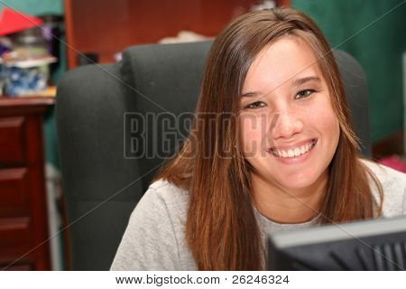 Smiling college student in front of her computer