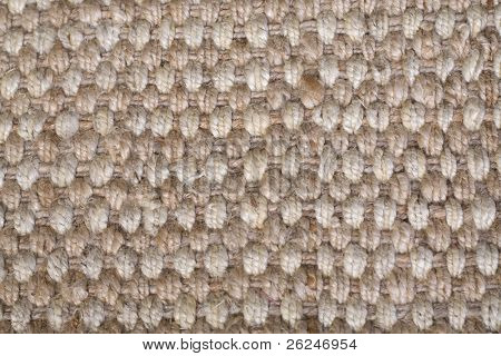 Woven rattan rug texture in neutral jute