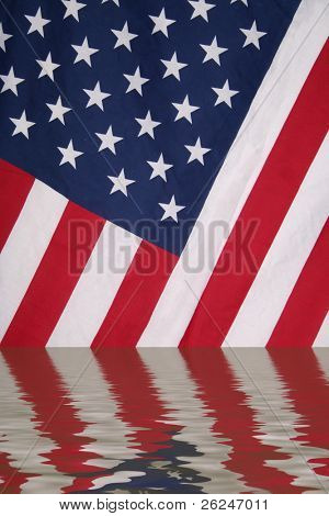 American flag reflected in water with ripples