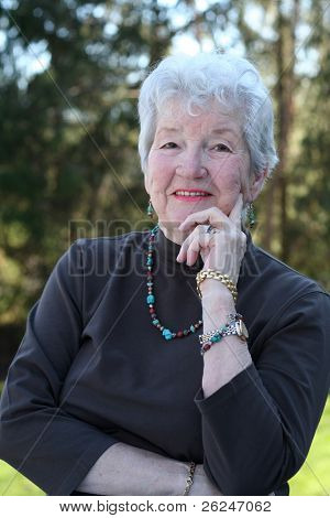 Smiling senior woman outside  with turquoise jewelry