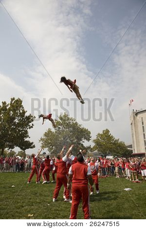Ohio State cheerleaders stunt before the game