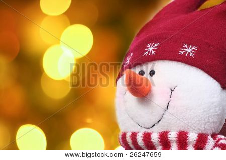 Festive snowman with a Christmas light background