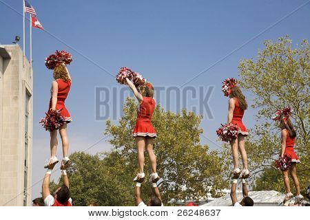 Cheerleader mount at a pep rally before the Ohio State game