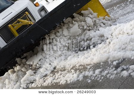 snow plow cleaning the street