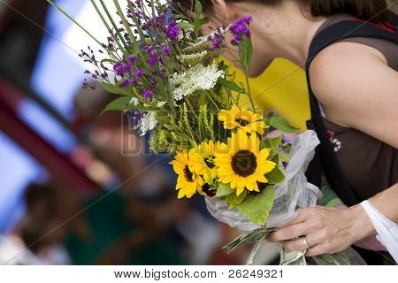 woman buying a bouquet of flowers at the North Market in Columbus, Ohio