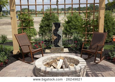 Beautiful backyard with a cozy fire pit and fountain