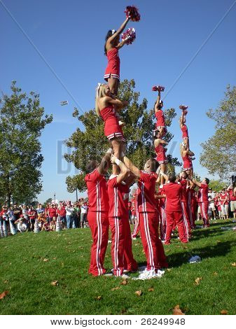 COLUMBUS, OHIO - SEPTEMBER 18: The Ohio State cheerleaders entertain the crowd before their game  on September 18, 2010 in Columbus, OH.