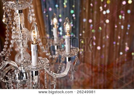 Elegant chandelier with a colorful background