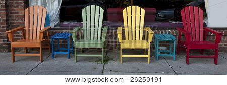 Colorful Adirondack chairs lined up for casual seating