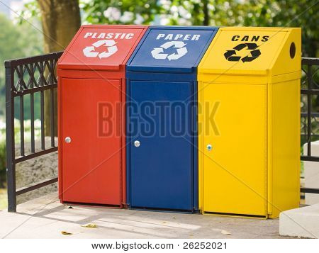 Three recycling bin for cans, plastic and paper. Environmental protection