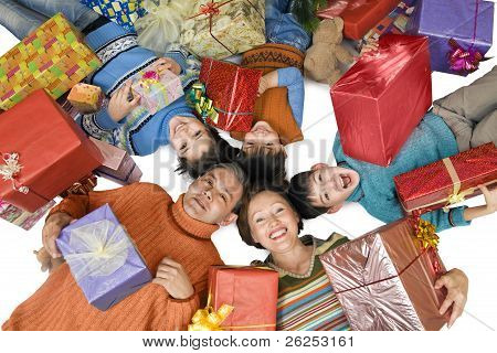 Cheerful Family With Gifts