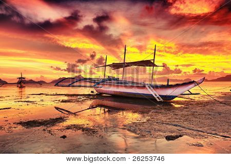 Traditional philippine boat bangka at sunset time