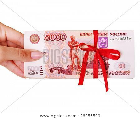 Female hand with  money (Russian rouble). Isolated.