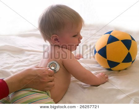 doctor listening patient kid with stethoscope