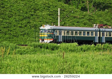 russian electric train on the green meadow