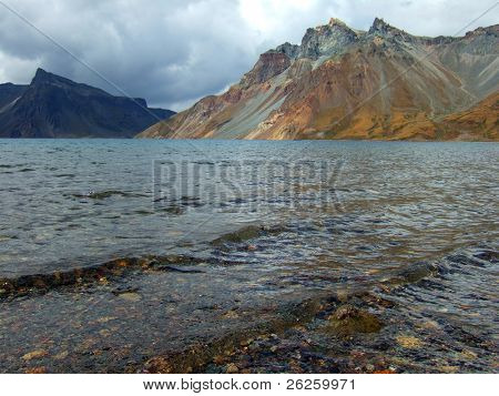 water surface of vulcanic lake on the top of famous North Korea Paktusan mountain